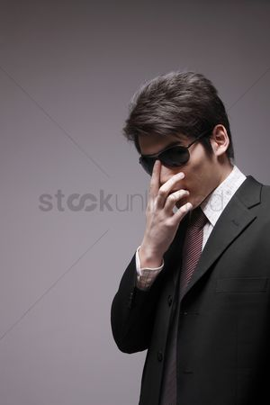 Man suit fashion : Man in full suit with sunglasses