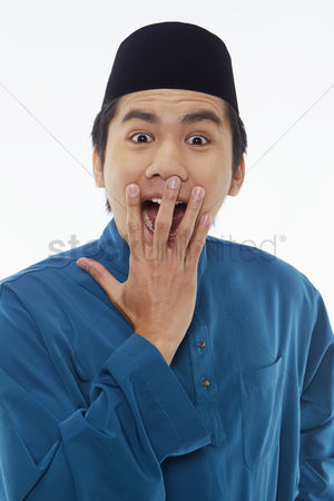 Traditional clothing : Man in traditional clothing looking surprised