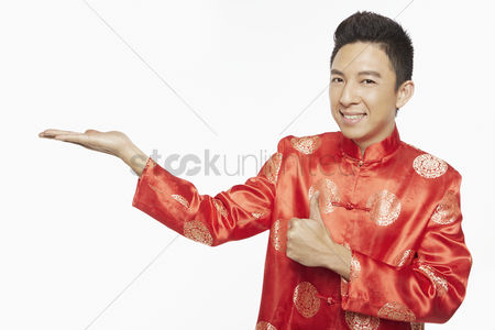 Traditional clothing : Man in traditional clothing showing hand gesture