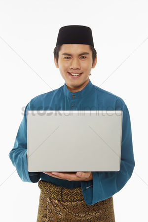 Portability : Man in traditional clothing using laptop
