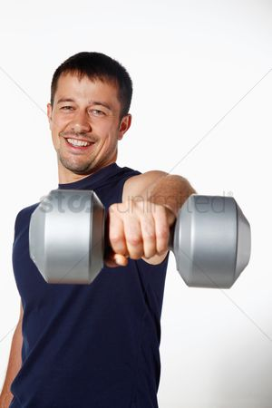 Dumbbell : Man lifting dumbbell