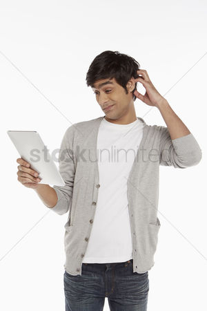 Portability : Man looking at digital tablet