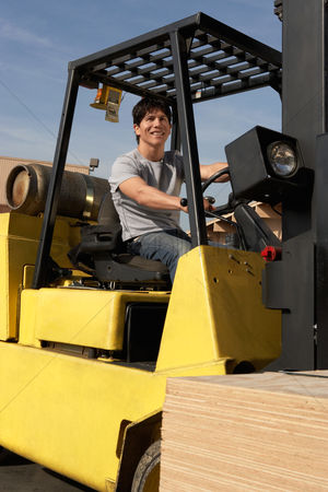 Forklift : Man operating forklift outside