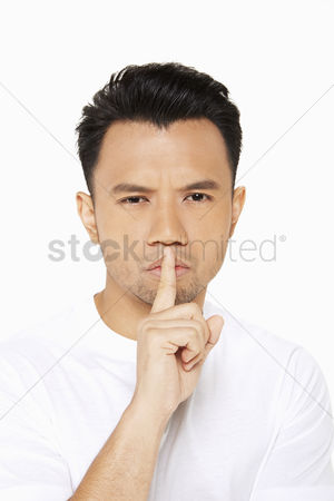Frowning : Man placing finger on his lips