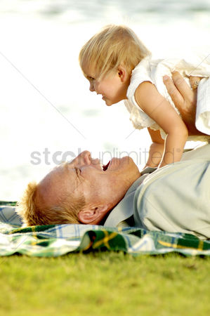 Adorable : Man playing with his young daughter