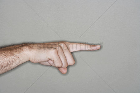 Instruction : Man pointing with index finger close-up of hand