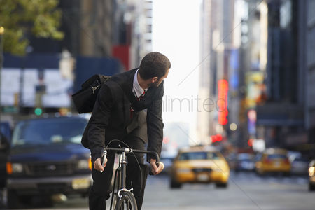 On the road : Man riding bicycle on street