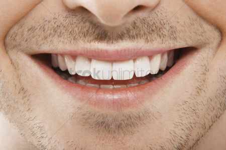Mid adult man : Man s mouth smiling