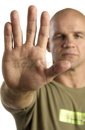 Bald : Man showing a stop gesture