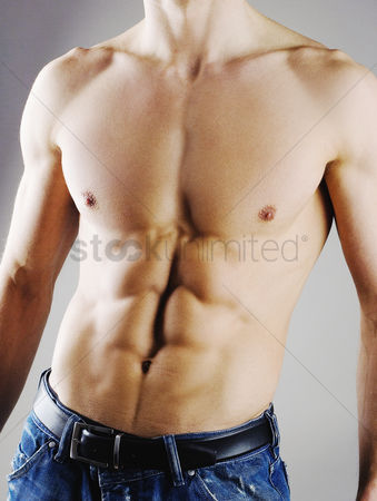 Strong : Man showing off his six-pack