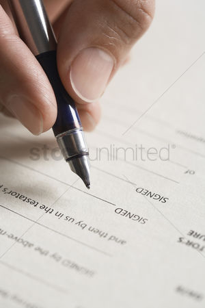 Finger : Man signing document close up of pen in hand
