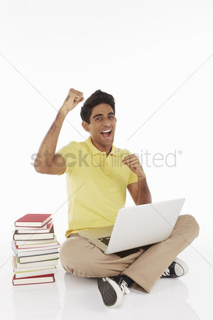 Portability : Man sitting and using laptop