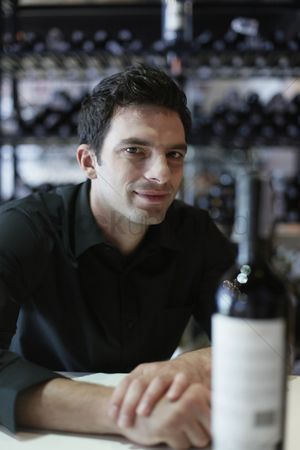 Wine bottle : Man sitting at the bar