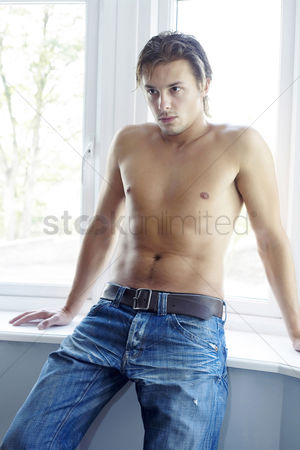 Fashion : Man sitting by the window thinking