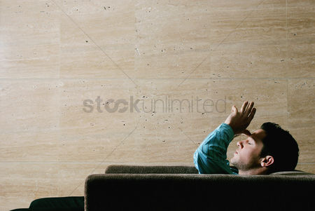 Thought : Man sitting on the couch thinking