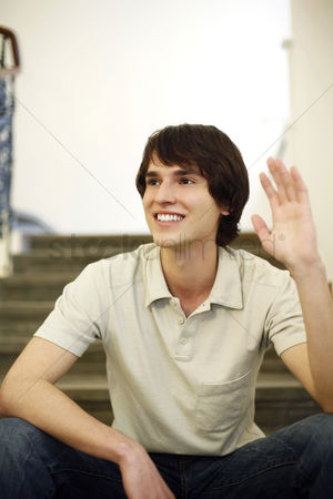 Steps : Man sitting on the staircase waving his hand