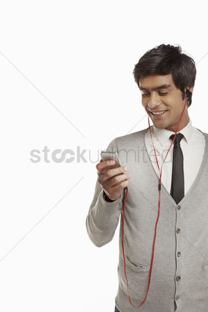 Earphone : Man smiling and using mobile phone