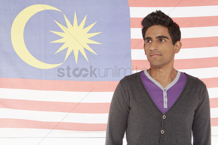 Malaysian indian : Man standing in front of a malaysian flag