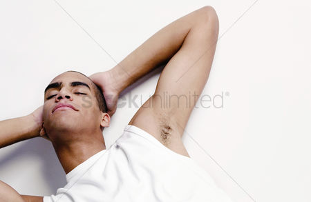 Modern lifestyle : Man taking a nap on the floor