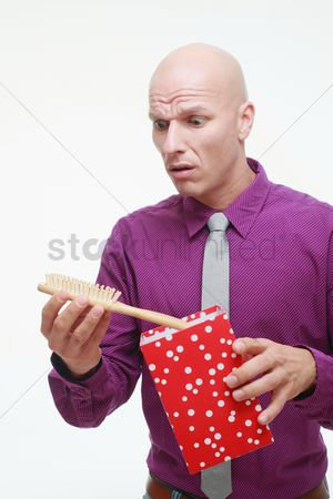 Birthday present : Man taking out a hair brush from gift box
