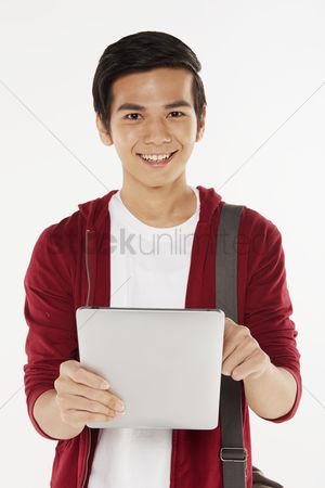 Portability : Man using a digital tablet