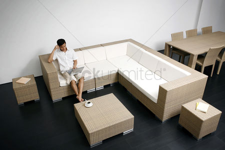 Furniture : Man using laptop