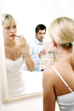 Careful : Man watching his wife applying lipstick