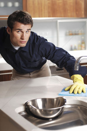 Obsessive : Man wiping the kitchen counter