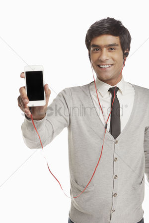 Earphone : Man with earphone holding up a mobile phone