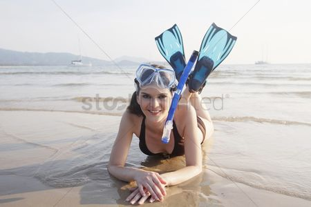 Diving : Man with scuba mask lying forward on the beach