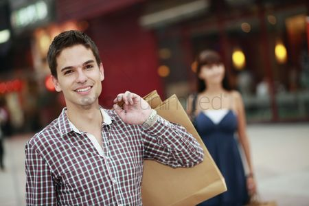 Spending money : Man with shopping bags smiling