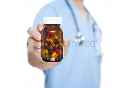 Medication : Medical personnel holding a pill bottle