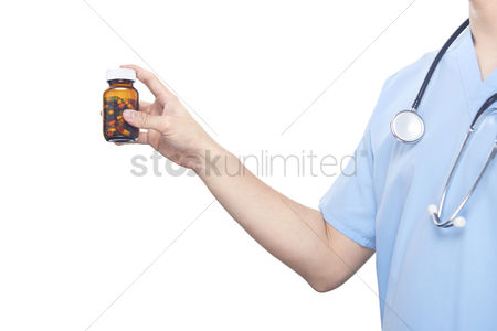 Medical personnel : Medical personnel holding a pill bottle