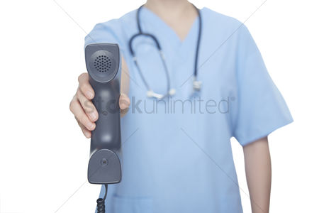 Medical personnel : Medical personnel holding a telephone receiver