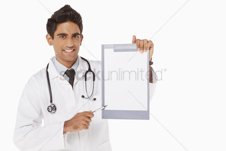 Medical personnel : Medical personnel holding up a blank clipboard