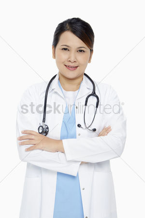 Medical personnel : Medical personnel standing with arms crossed  smiling