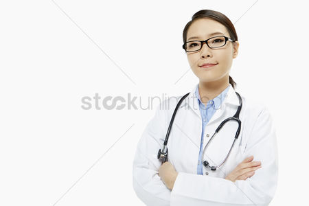 Asian : Medical personnel with arms crossed  smiling