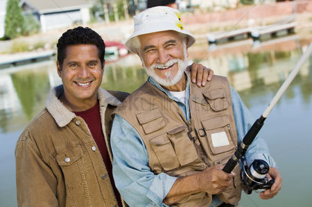 Offspring : Middle-aged man and son fishing smiling  portrait