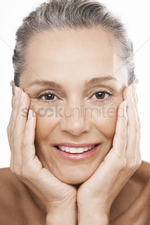 Head shot : Middle-aged woman head in hands