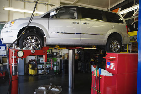 Transportation : Minivan on a lift in shop