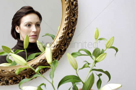 Housewife : Mirror reflection of woman