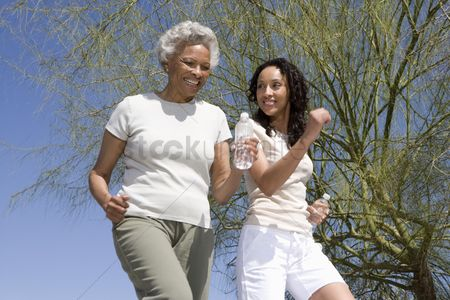 Two people : Mother and daughter jog together