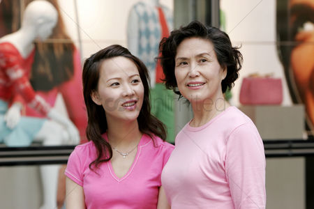 Aging process : Mother and daughter shopping together