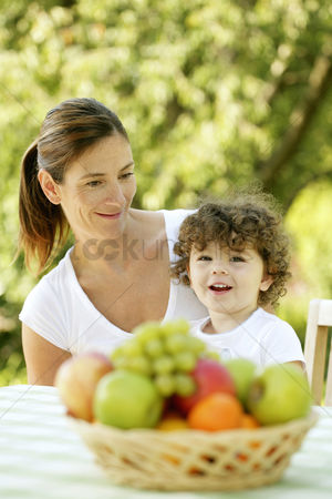 Grapes : Mother and daughter sitting at the picnic table