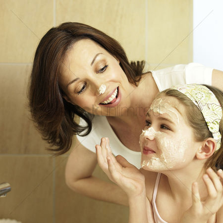 Enjoying : Mother and daughter washing face in the bathroom