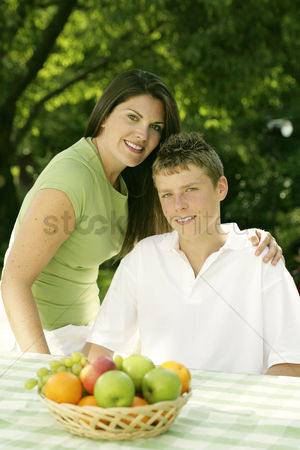 Green grapes : Mother and son posing at the picnic table