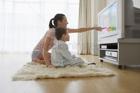 Sets : Mother and son watching television