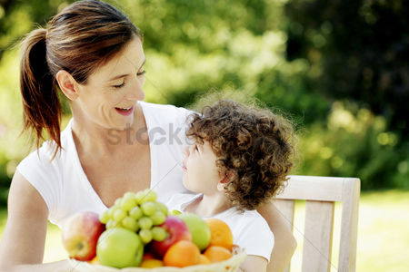 Smile : Mother talking to her daughter