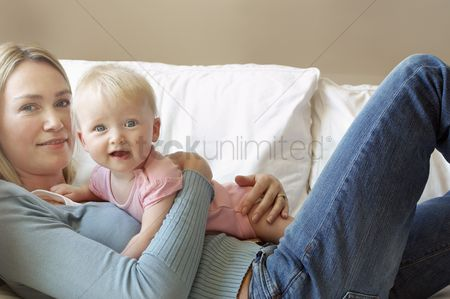 Denim : Mother with daughter on sofa