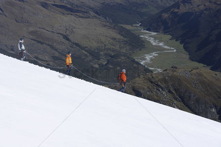 Rope : Mountain climbers descending snowy slope